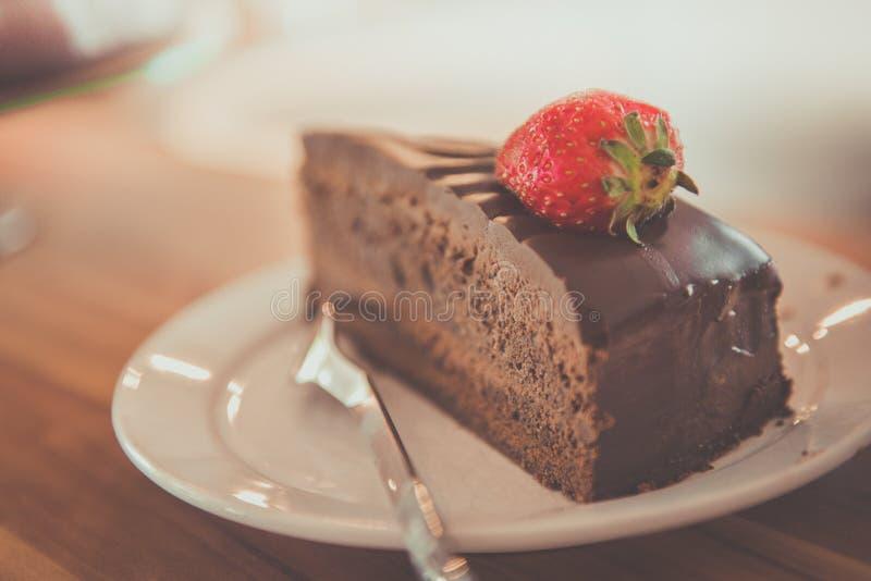 Chocolate cake with strawberry stock photos