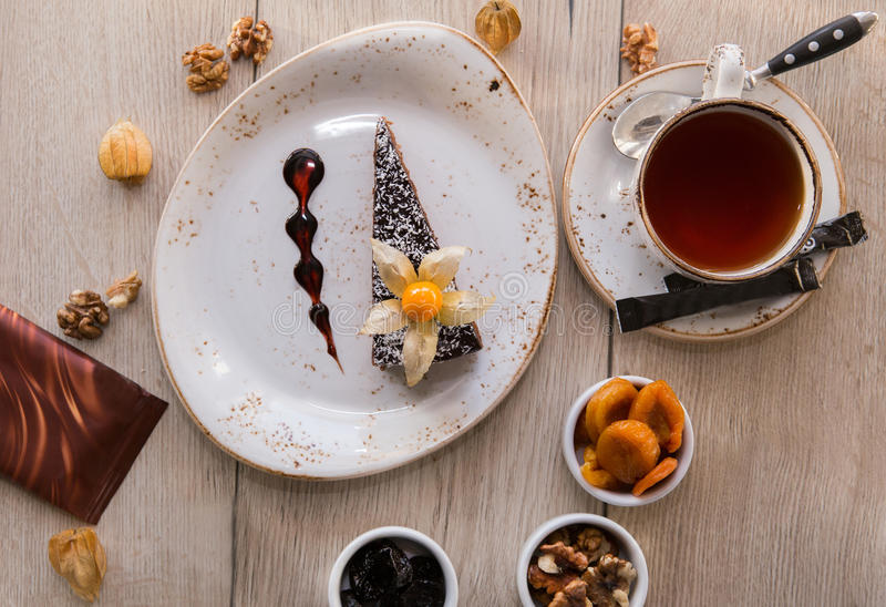 Chocolate cake with tea and jam. stock photography