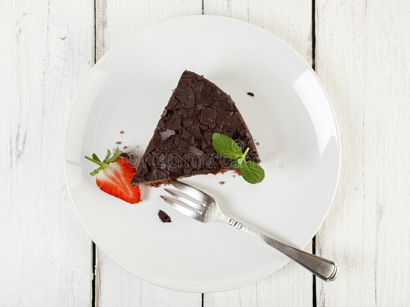Chocolate cake, top view. Piece of chocolate cake and strawberries on a plate, high angle view stock photos
