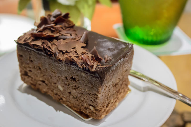 Chocolate cake and toppings. Dark chocolate cake with toppings for coffee break stock photography