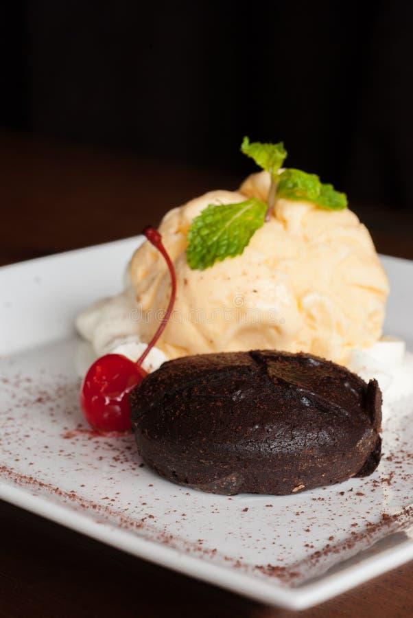 Chocolate cake with vanilla icecream,Fondant au chocolat. Hot Chocolate Pudding , Fondant au chocolat with vanilla icecream royalty free stock image