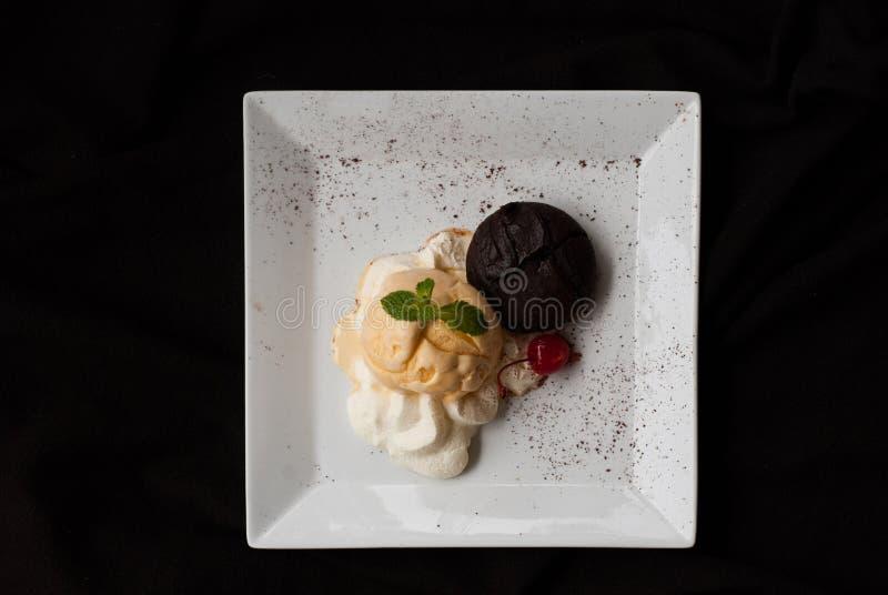 Chocolate cake with vanilla icecream,Fondant au chocolat. Hot Chocolate Pudding , Fondant au chocolat with vanilla icecream royalty free stock photos