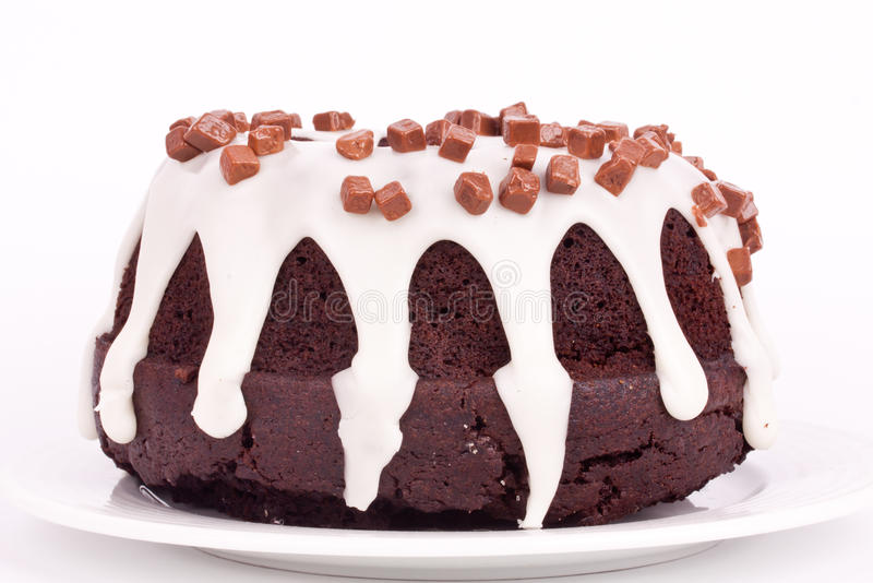 Chocolate cake with vanilla sauce royalty free stock images