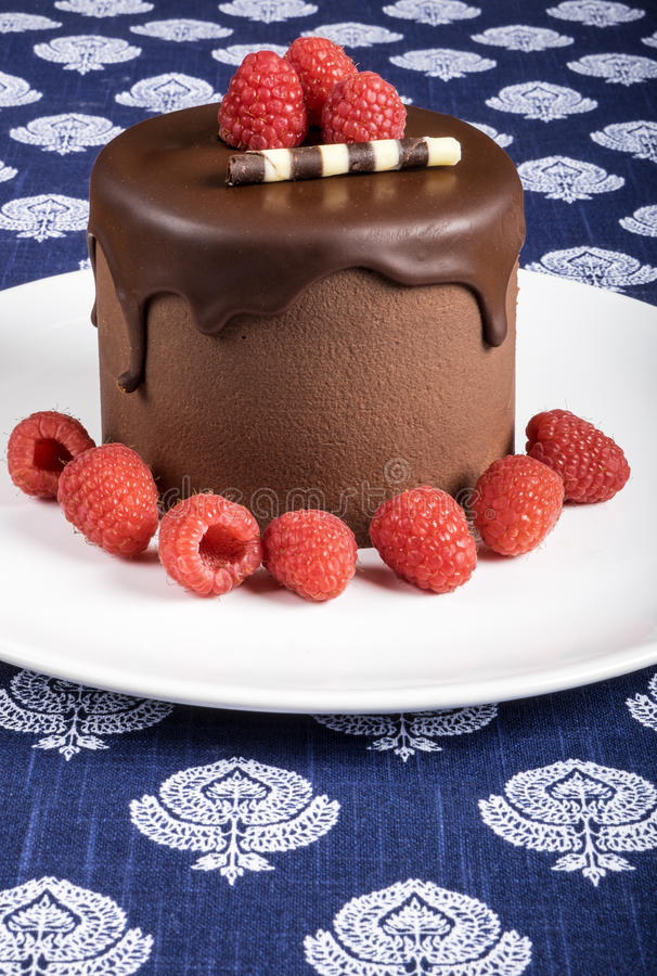 Chocolate Cake on White Plate Decorated with Raspberries #3 stock image