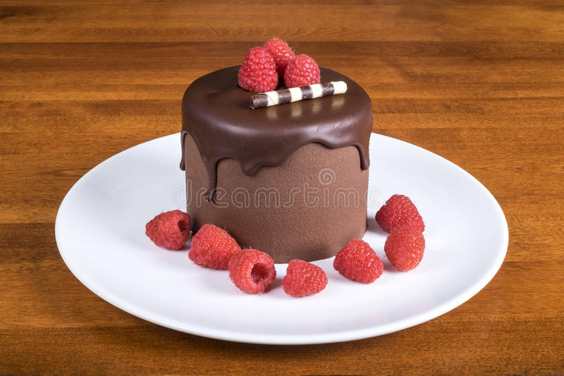 Chocolate Cake on White Plate Decorated with Raspberries #2 stock images