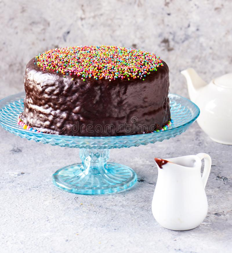 Free Chocolate Cake With With White Teapot At Tea Time Royalty Free Stock Image - 158573946