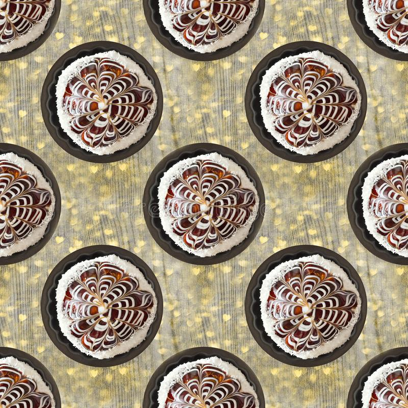 Chocolate cakes on a wooden background with hearts royalty free stock images