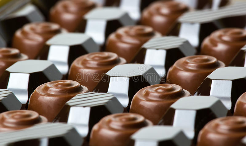 Chocolate candies stock images