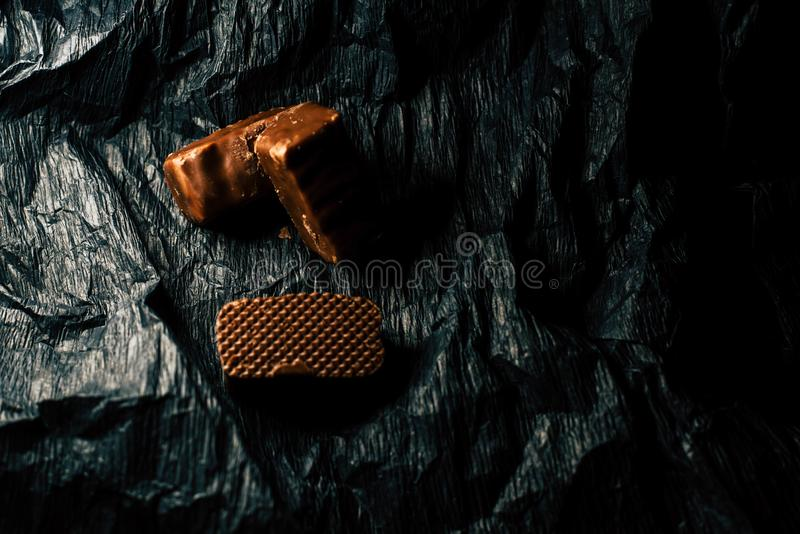 Chocolate candies on a black background stock photo