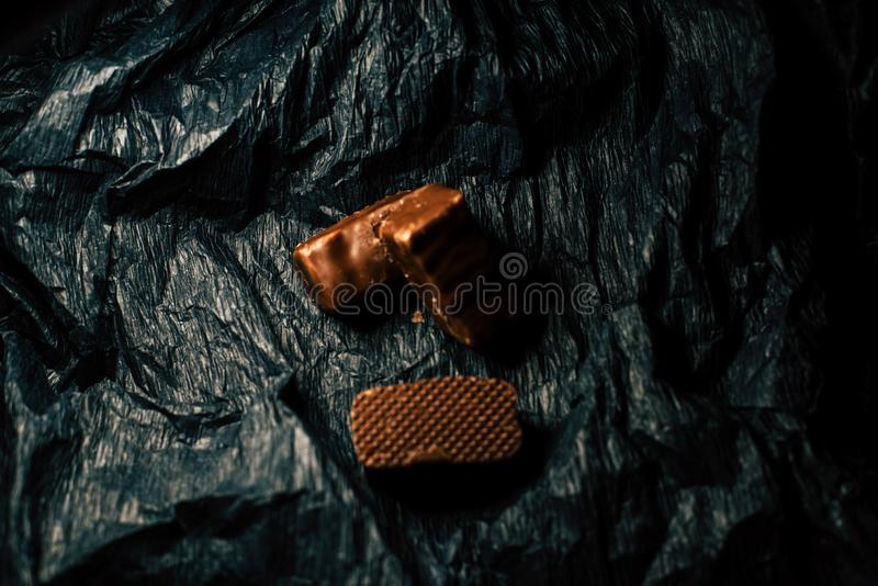 Chocolate candies on a black background stock photos