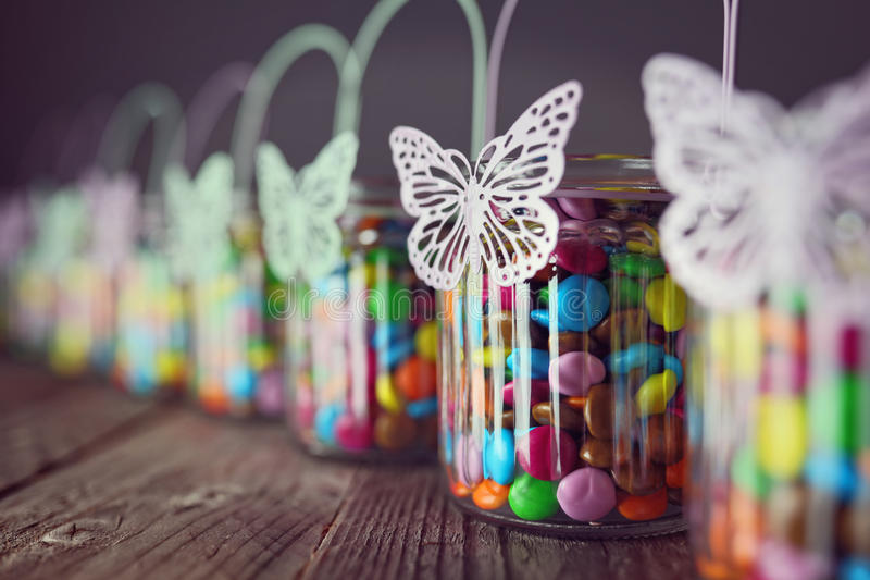 Chocolate candies in jars royalty free stock photo