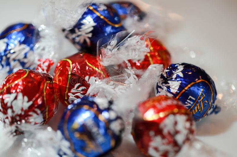 Chocolate candies Lindt Lindor. Candy in multi-colored wraps. Illustrative editorial royalty free stock images
