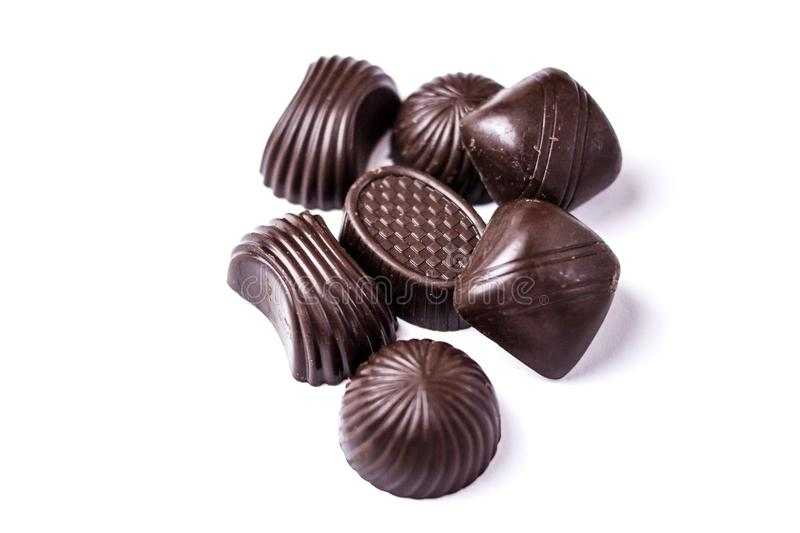 Chocolate candies on a white background royalty free stock images