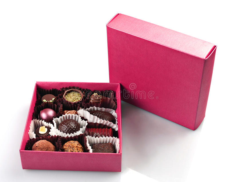 Chocolate candy in box. Chocolate candy group in purple box on white stock photos