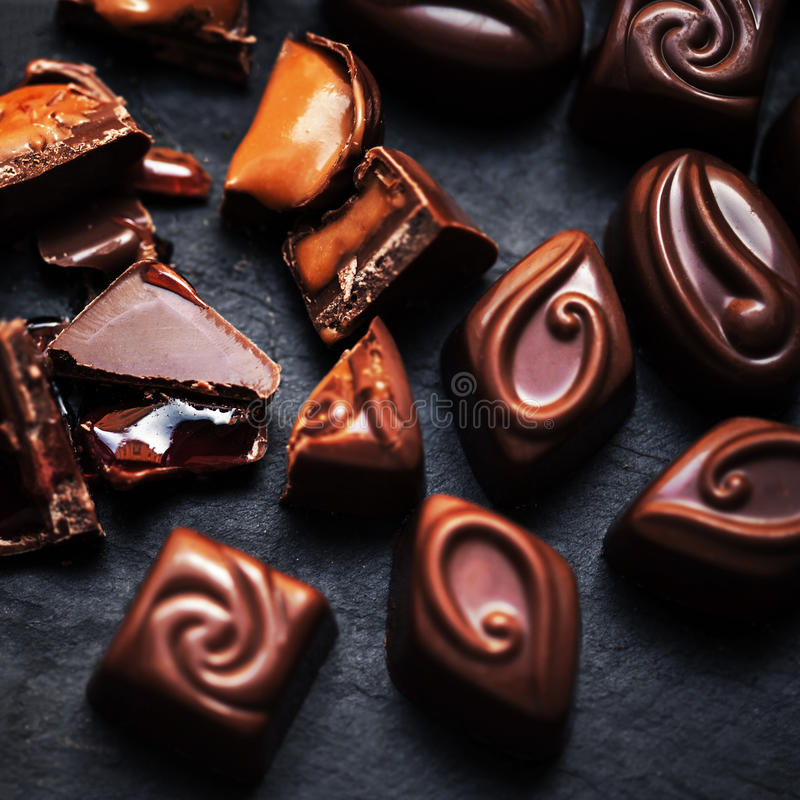 Chocolate candy close up on dark background. Chocolate Candies, stock photo