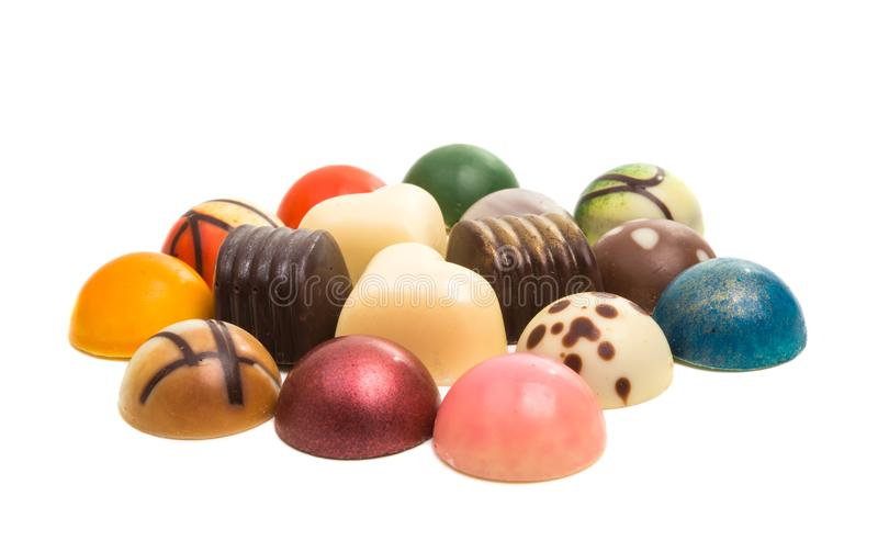 Chocolate candy in colored glaze isolated. On white background stock image