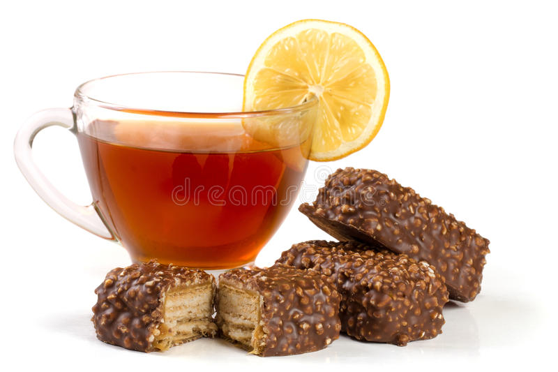 Chocolate candy with a cup of tea isolated on white background.  stock photo