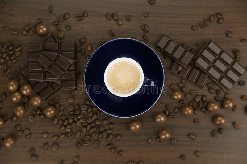 Chocolate candy with hot coffee and coffee beans royalty free stock images