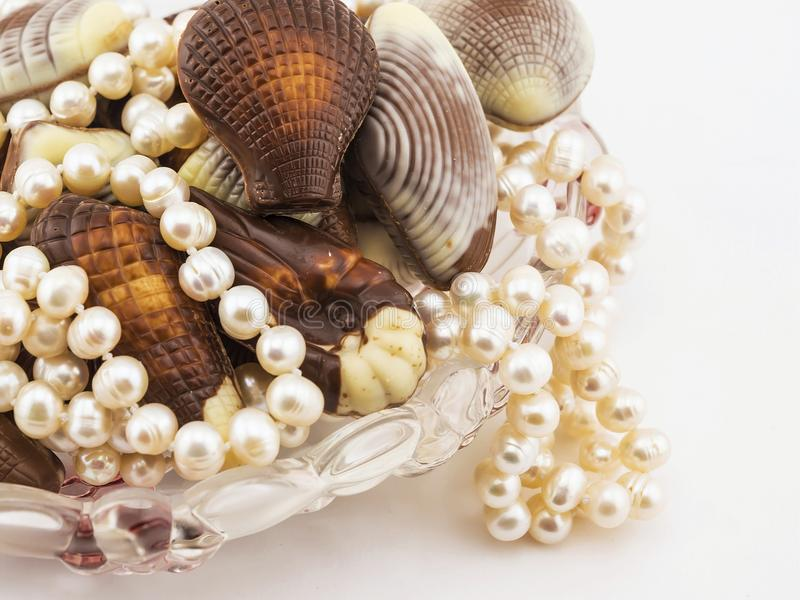 Chocolate candy seashells and pearls royalty free stock photos