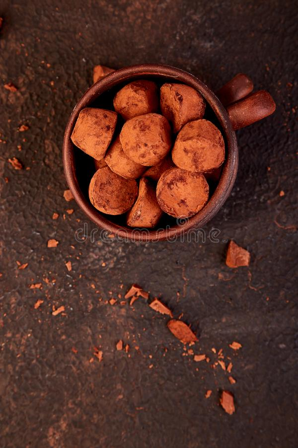 Chocolate Candy truffles in brown plate royalty free stock photography