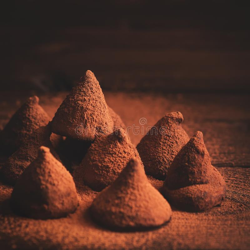 Chocolate truffles candies on rustic wooden background. Dark food photo. Selective focus. Chocolate Candy truffles on rustic background. Dark food photo stock photos