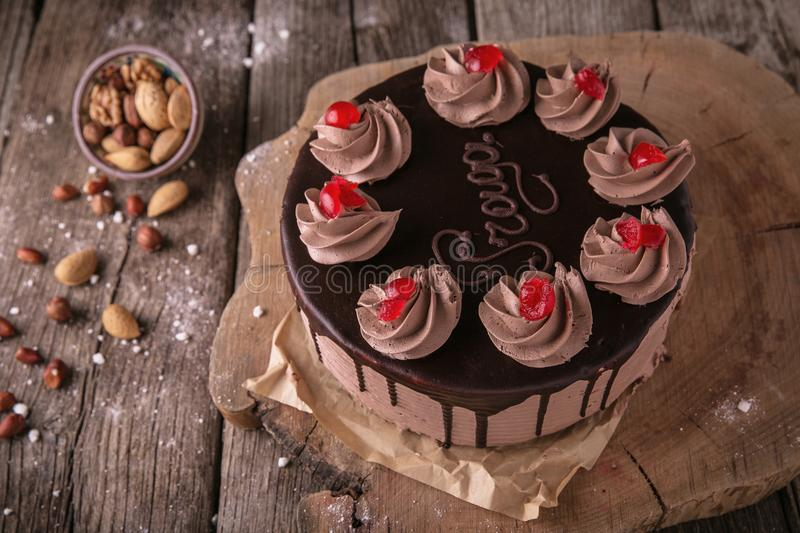 Chocolate caramel cake Prague on wooden boards stock photography