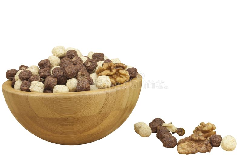 Chocolate cereal balls in a bowl of bamboo. Healthy breakfast with fruit and milk. A diet full of energy and fiber for athletes. royalty free stock photography