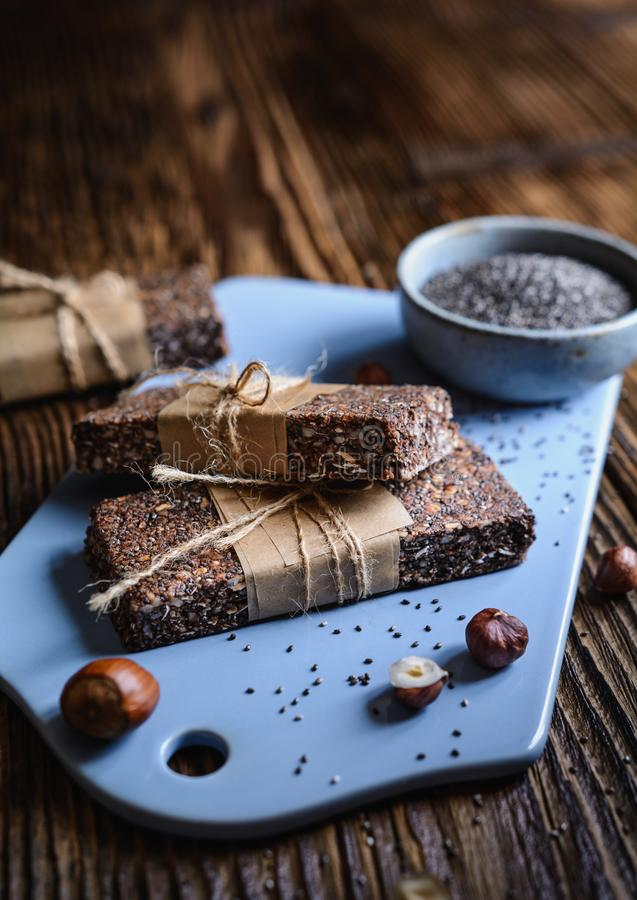 Chocolate chia seeds bars with hazelnuts, rolled oats, dates, coconut and honey royalty free stock photos