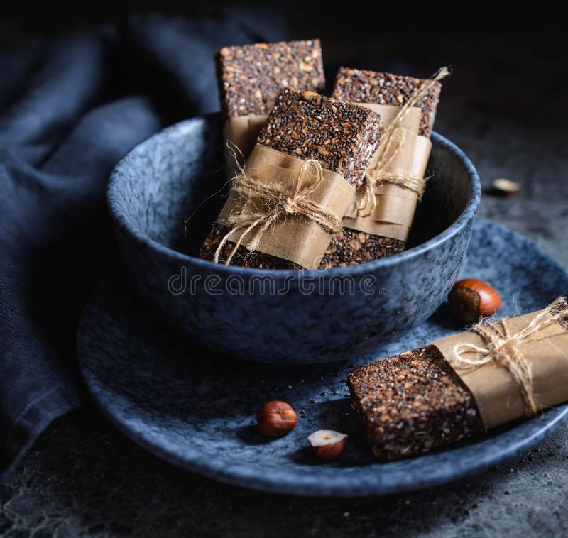 Chocolate chia seeds bars with hazelnuts, rolled oats, dates, coconut and honey royalty free stock photography