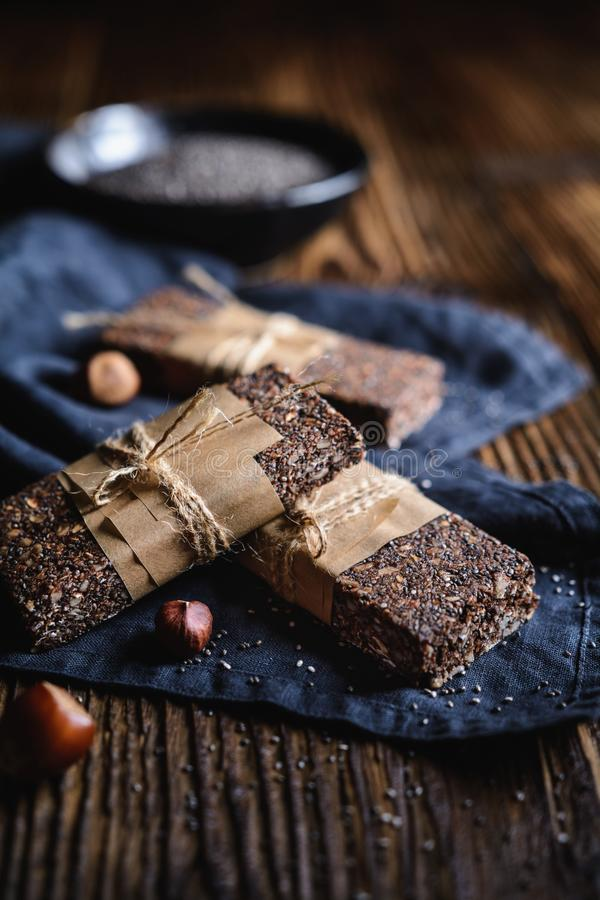 Chocolate chia seeds bars with hazelnuts, rolled oats, dates, coconut and honey royalty free stock image