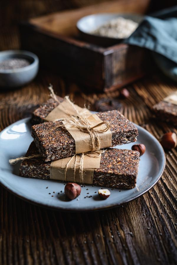 Chocolate chia seeds bars with hazelnuts, rolled oats, dates, coconut and honey stock images