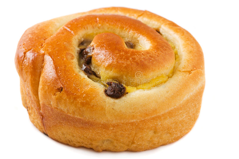 Chocolate chip brioche bun over white royalty free stock photography