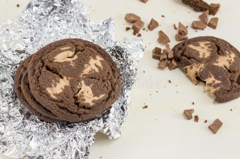 Chocolate chip brown cookies. On aluminum foil royalty free stock photography