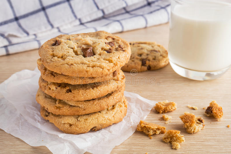 Chocolate chip cookie with almond and milk glass. Chocolate chip cookie with almond and a milk glass royalty free stock photo