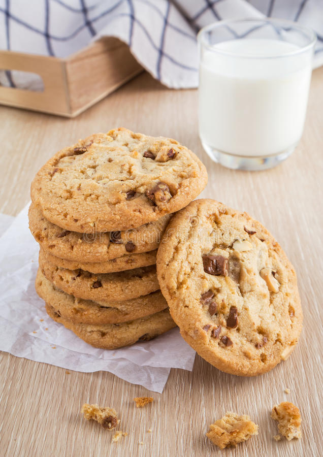 Chocolate chip cookie with almond and milk glass. Chocolate chip cookie with almond and a milk glass stock photo