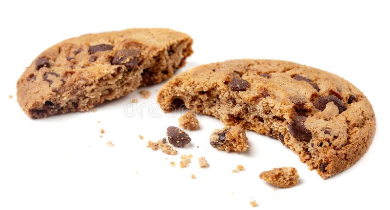 Chocolate chip cookie with crumbs and pieces  isolated on white background. Crushed cookies. Chocolate chip cookie with crumbs and pieces isolated on white royalty free stock photography