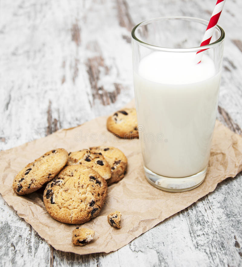 Chocolate chip cookie and glass of milk stock images