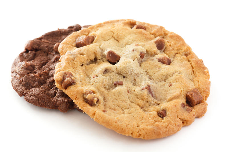 Chocolate chip cookie. Large light chocolate chip cookie on a white surface brown food sweet stock image