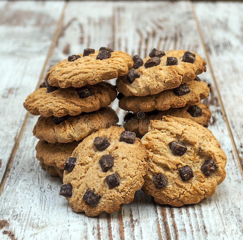 Chocolate chip cookie. Surrounded by rustic background stock images