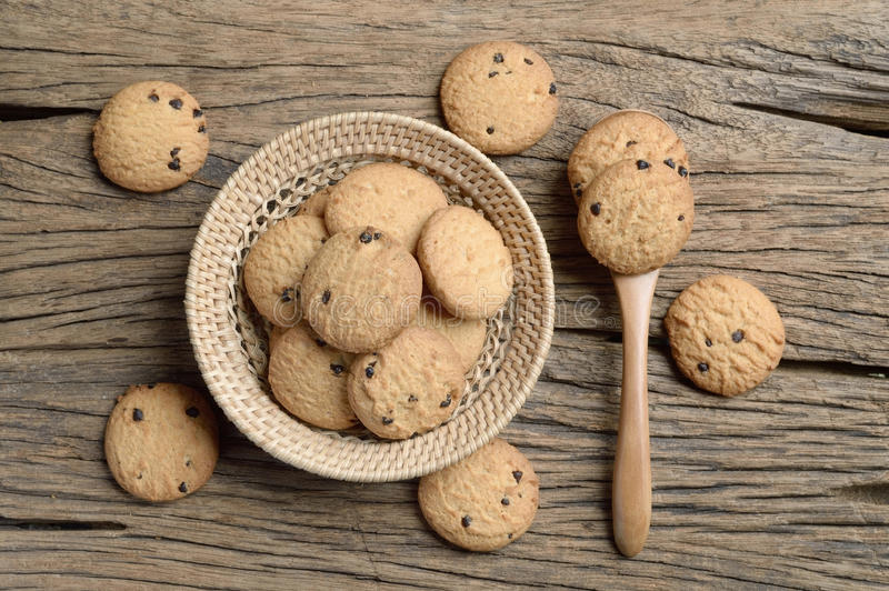Chocolate chip cookie. In wicker basket on wooden table stock images