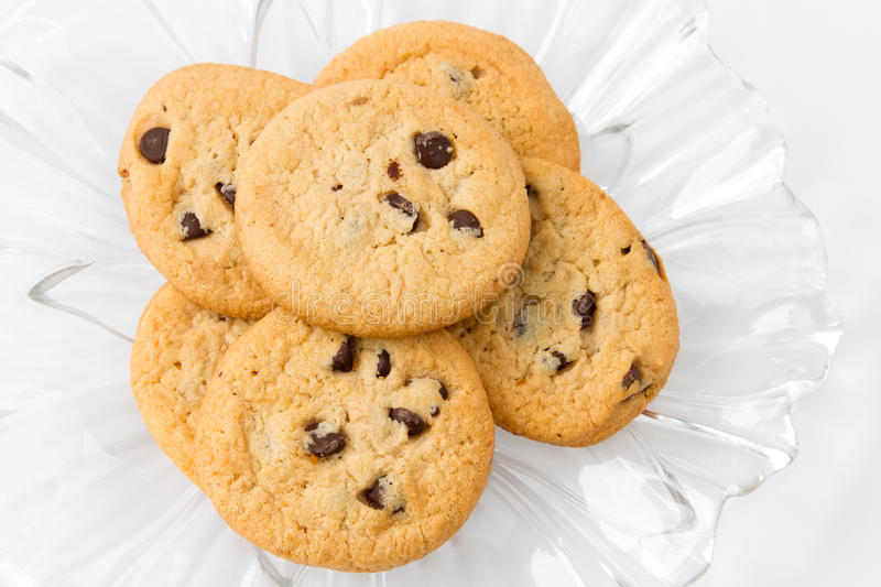 Chocolate chip cookies. A selection of chocolate chip cookies on a decorative glass plate stock photo