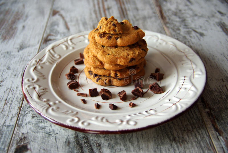 Chocolate chip cookies. Biscuits with chocolate drops on old wooden table stock images