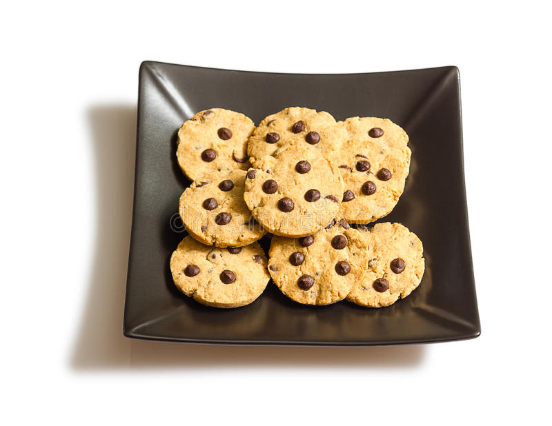 Chocolate chip cookies on a black plate o stock images