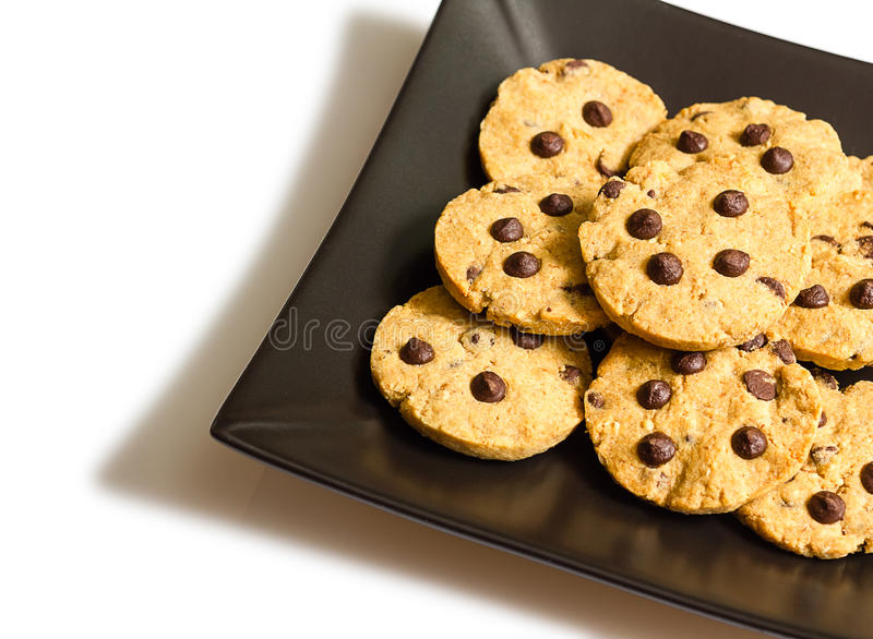 Chocolate chip cookies on a black plate on white backgr royalty free stock photo