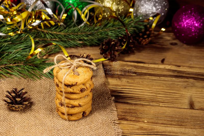 Chocolate chip cookies with Christmas decoration on wooden table royalty free stock photo