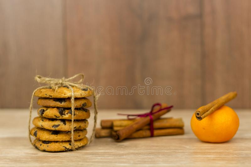 Chocolate chip cookies. Cinnamon sticks, cardamom and star anise. royalty free stock photography
