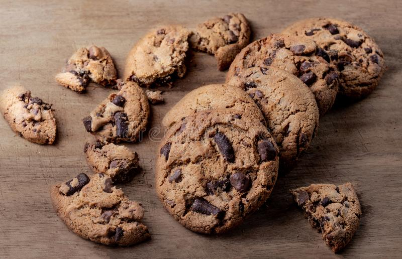 Chocolate chip cookies on a dark wood table, top view royalty free stock photography