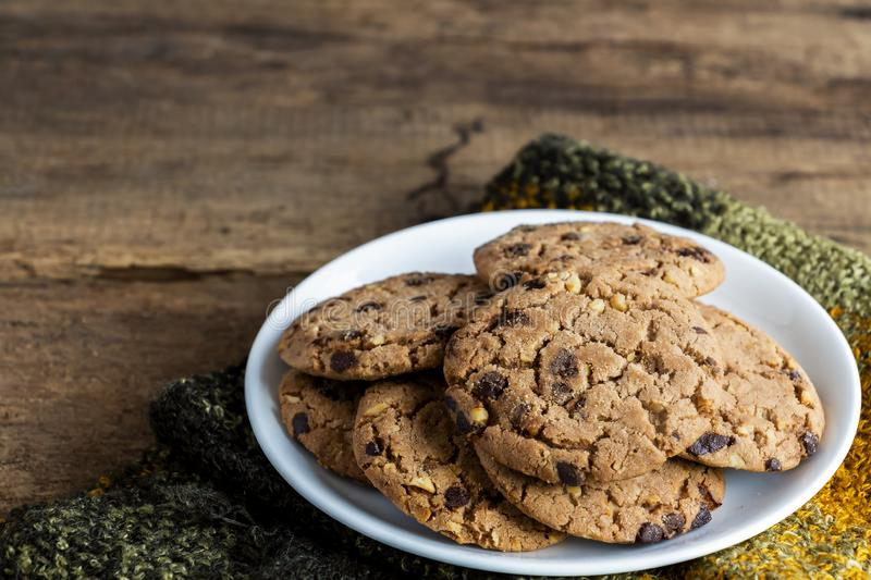 Chocolate chip cookies freshly baked are pile on white plate wit royalty free stock photography