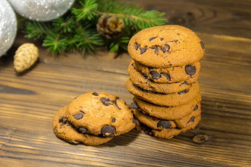 Chocolate chip cookies in front of Christmas decoration on wooden table stock photography