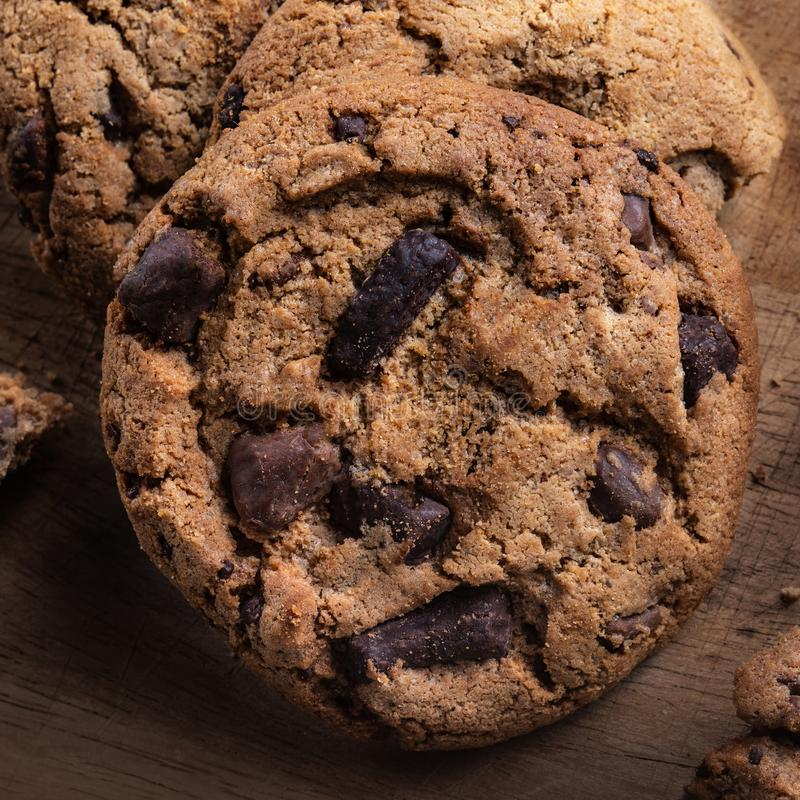 Chocolate chip cookies on wooden table. Top view stock photos